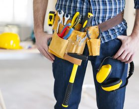 Part of construction worker with tools belt